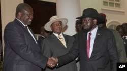 FILE - Former Vice President of South Sudan Riek Machar, left, greets South Sudan President Salva Kiir, right, as Uganda President Yoweri Museveni looks on, July 7, 2018, Uganda. A report released Thursday says Uganda diverted European weapons to South Sudan despite an EU ban.