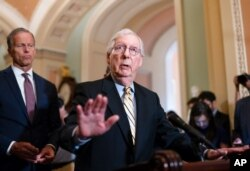 Senate Minority Leader Mitch McConnell, R-Ky., j talks with reporters at the Capitol in Washington, June 22, 2021.