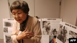 FILE - Kaz Suyeishi, of the American Society of Hiroshima-Nagasaki A-Bomb Survivors, describes seeing an atomic explosion over Japan during World War II, at a press conference in Los Angeles, California.