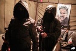 Militants of the Kurdistan Workers' Party, or PKK, stand in a bunker in Sirnak, Turkey, Dec. 23, 2015.