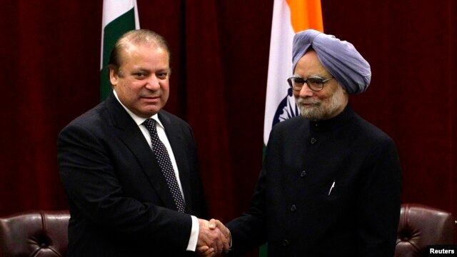 FILE - Pakistan's Prime Minister Nawaz Sharif (L) shakes hands with India's Prime Minister Manmohan Singh during the United Nations General Assembly in New York.