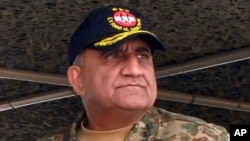 FILE - Pakistan's Qamar Javed Bajwa attends a military exercise in Khairpur Tamiwali, Pakistan, Nov. 16, 2016.