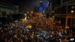 Tens of thousands of pro-democracy activists demonstrate in Hong Kong October 1st.