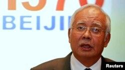 Thủ tướng Malaysia Najib Razak phát biểu trước các phóng viên về sự mất tích của chuyến bay MH370, tại sân bay quốc tế Kuala Lumpur, 15/3/2014