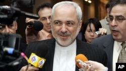 FILE - Javad Zarif, Iranian Ambassador to the United Nations speaks to reporters after Security Council consultations regarding Iraq, Iran and other matters at U.N. headquarters in New York, March 21, 2007