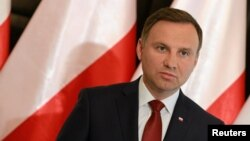 FILE - President Andrzej Duda speaks during a press conference in Warsaw, Poland.