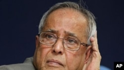 Indian Finance Minister Pranab Mukherjee listens to a question during a press conference in New Delhi, India, January 25, 2011