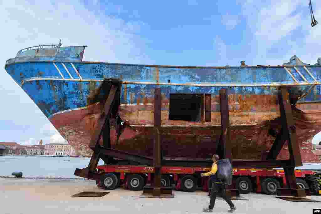 "The fishing vessel ""Barca Nostra"" (Our Ship) that sank on April 18, 2015, trapping hundreds of migrants in its hull, is being installed in Venice's former shipyards, Italy, as part of the centerpiece of a new art project by Swiss-Icelandic artist Christoph Buechel, prior to the the 58th International Art Exhibition of the Venice Biennale, May 7, 2019."