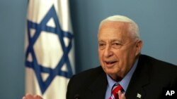 FILE - Israeli Prime Minister Ariel Sharon speaks during a press conference at his Jerusalem office, Nov. 21, 2005.