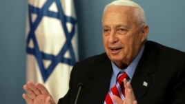In this file photo taken on Monday, Nov. 21, 2005, Israeli Prime Minister Ariel Sharon speaks during a press conference at his Jerusalem office.