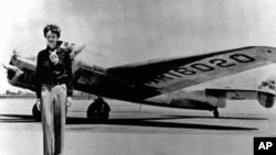 Amelia Earhart, 40, stands next to a Lockheed Electra 10E, before her last flight in 1937 from Oakland, Calif., bound for Honolulu.