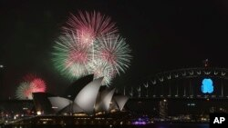 Fireworks over the Opera House and the Harbour Bridge in Sydney