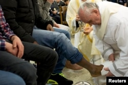 FILE - Pope Francis washes the foot of a prisoner at Casal del Marmo youth prison in Rome March 28, 2013.