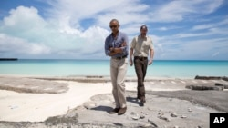 President Barack Obama and Marine National Monuments Superintendent Matt Brown visit Turtle Beach during a tour of Midway Atoll in the Papahanaumokuakea Marine National Monument, Northwestern Hawaiian Islands, Sept. 1, 2016.