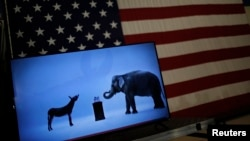 The mascots of the Democratic and Republican parties, a donkey for the Democrats and an elephant for the GOP, are seen on a video screen at Democratic U.S. presidential candidate Hillary Clinton's campaign rally in Cleveland, Ohio, March 8, 2016.