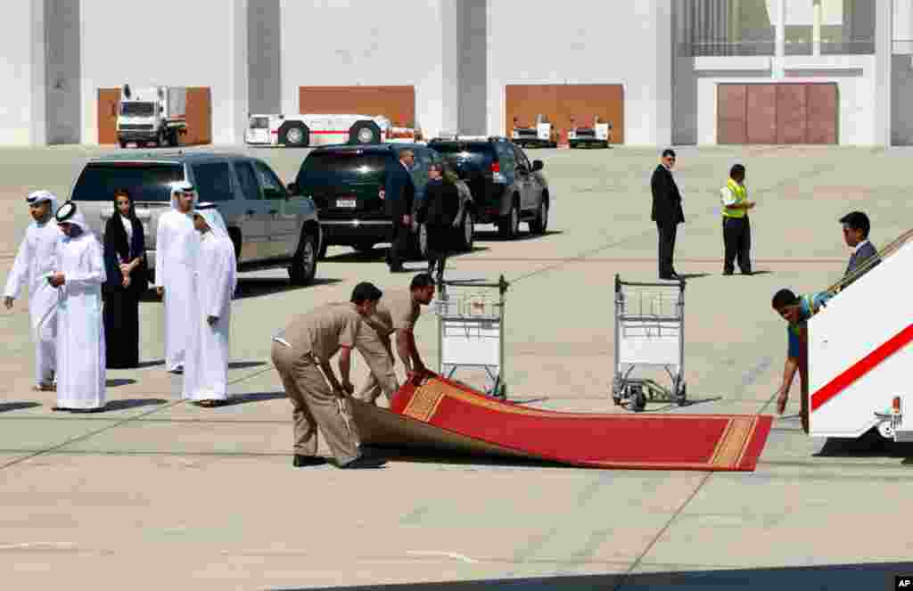 The red carpet is rolled up after U.S. Secretary of State John Kerry boarded his plane to leave Abu Dhabi, United Arab Emirates on his way to the final destination of Qatar, March 5, 2013.