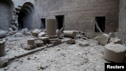 Damaged pillars lie on the ground in a square in Bosra's ancient citadel after what activists said was an airstrike by forces loyal to Syria's president Bashar al-Assad, in the town of Bosra al-Sham, Deraa, Dec. 23, 2015.