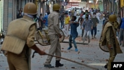 Indian police clash with Kashmiri protesters in Srinagar on July 11, 2016.