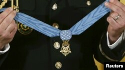 FILE - The Medal of Honor is seen before presentation in the East Room of the White House in Washington Nov. 12, 2015. A Navy SEAL who helped rescue an American hostage in Afghanistan will be the nation's next Medal of Honor recipient, the White House announced on Tuesday.