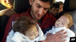 Abdul-Hamid Alyousef, 29, holds his twin babies, who were killed during a suspected chemical weapons attack, in Khan Sheikhoun in the northern province of Idlib, Syria, April 4, 2017. Alyousef also lost his wife, two brothers, nephews and many other family members in the attack that claimed scores of his relatives.