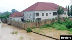Newly-built houses on the bank of the River Kaduna are seen in flood waters after hours of rainfall in Kaduna, Nigeria, Aug. 15, 2015.