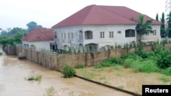 Newly-built houses on the bank of the River Kaduna are seen in flood waters after hours of rainfall in Kaduna, Nigeria August 15, 2015.