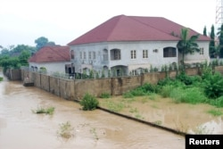 FILE - Newly-built houses on the bank of the River Kaduna are seen in flood waters after hours of rainfall in Kaduna, Nigeria, August 15, 2015.