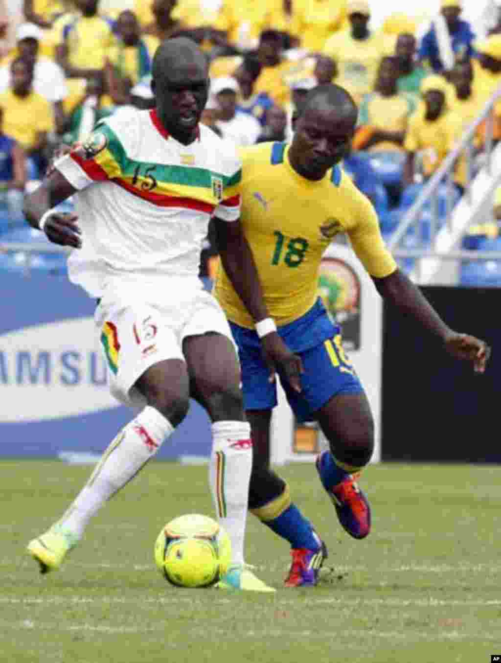 Mali's Bakaye Traore (L) fights for the ball with Gabon's Cedric Moubamba during their African Cup of Nations quarter-final soccer match at the Stade De L'Amitie Stadium in Gabon's capital Libreville, February 5, 2012.