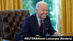 USA, Washington, U.S. President Joe Biden smiles after signing executive orders strengthening access to affordable healthcare