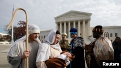 "Actors dressed for a nativity scene held their annual ""Live Nativity on Capitol Hill"" on Tuesday."