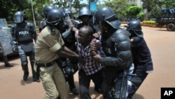 FILE - Critics say enforcement tactics by Uganda police are dictated by the government and are intended to intimidate the opposition. On March 28, 2012, police detained a supporter of opposition leader Kizza Besigye.