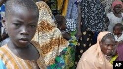 Yara da mata da Boko Haram ta raba da muhalli.