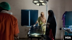 A nurse prepares the operating table for surgery, Ras Kamboni, Somalia, July 6, 2012. (VOA - R. Gogineni)