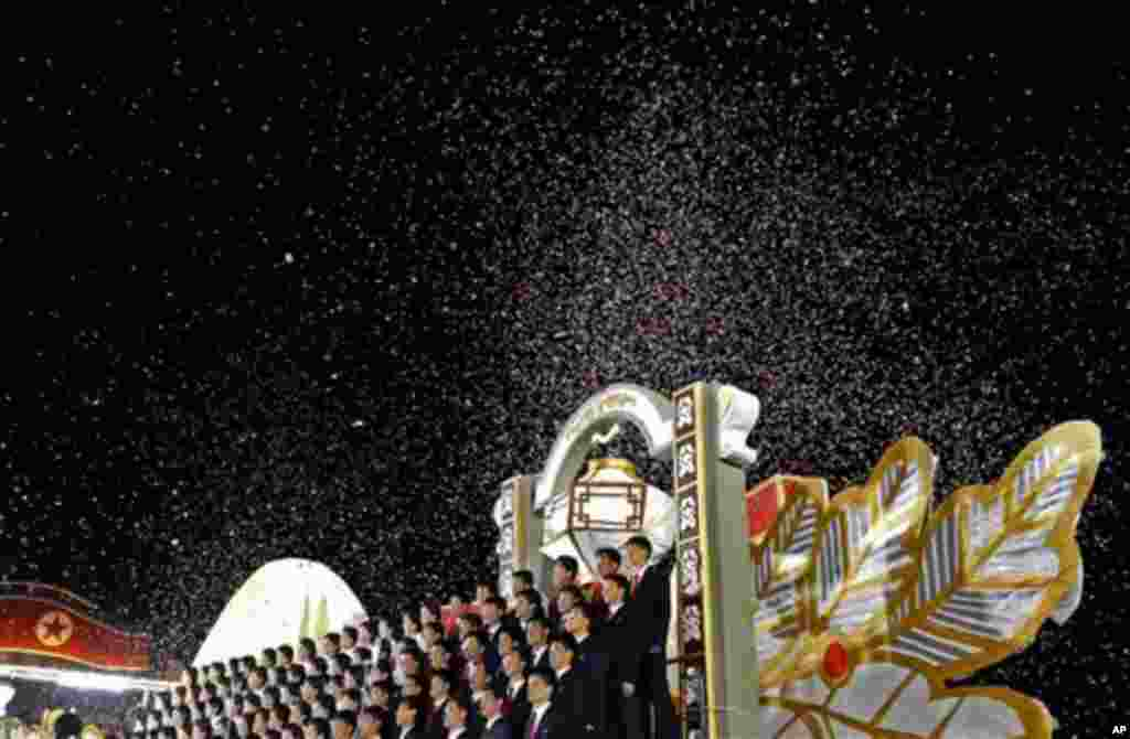 North Korean singers perform at Kim Il Sung Square in Pyongyang, North Korea, to celebrate 100 years since the birth of the North Korean founder Kim Il Sung, Monday, April 16, 2012. (AP Photo/Vincent Yu)