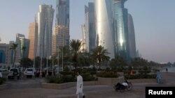 FILE - A man walks on the corniche in Doha, Qatar, June 15, 2017.