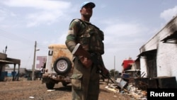 A United Nations peacekeeper on patrol in the town of Malakal, Upper Nile State.