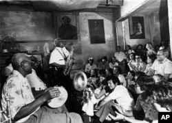 The musicians of Preservation Hall entertain jazz fans in the French Quarter of New Orleans, May 12, 1964.