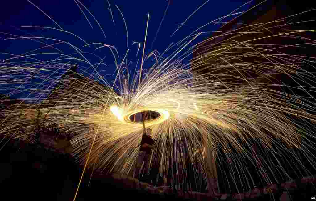 Palestinians light fireworks to celebrate the holy month of Ramadan in Gaza City, May 13, 2019.
