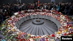 File - People attend a commemoration ceremony to mark the centenary of the mass killing of Armenians by Ottoman Turks at the Tsitsernakaberd Memorial Complex in Yerevan, Armenia, April 2015.