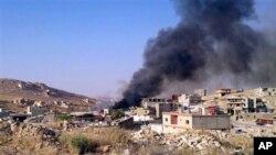 ຄວັນໄຟ ກຸ້ມຂຶ້ນຈາກເມືອງ Arsal, ໃກ້ກັບຊາຍແດນຊີເຣຍ ໃນພາກຕາເວັນອອກຂອງເລບານອນ, ວັນທີ 2 ສິງຫາ 2014