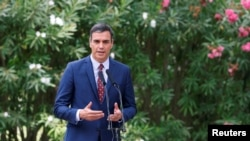 FILE PHOTO: Spain's Prime Minister Pedro Sanchez speaks during a brief news conference after his traditional summer meeting with King Felipe at Marivent Palace in Palma de Mallorca, Aug. 7, 2019.