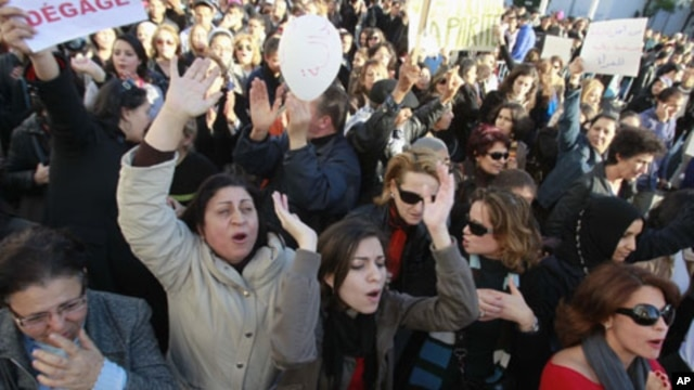 Women gesture during a protest in Tunis, January 29, 2011