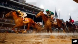 Flavien Prat rides Country House, left, to victory in the 145th running of the Kentucky Derby horse race, May 4, 2019, in Louisville, Ky. Code of Honor, right, finished second. Luis Saez on Maximum Security finished first but was disqualified.