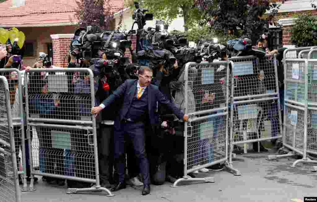 A security official holds barriers during the arrival of Saudi officials at Saudi Arabia's consulate in Istanbul, Turkey October 15, 2018.