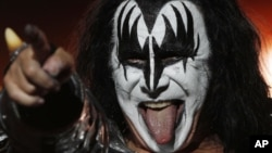 Gene Simmons of the music group Kiss performs during a concert in Mexico City, Saturday, Sept. 29, 2012. (AP Photo/Marco Ugarte)