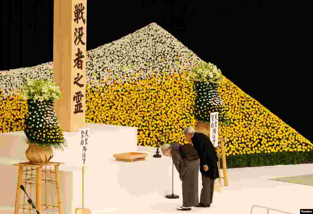 Japan's Emperor Akihito (R) and Empress Michiko honor the war dead during a memorial ceremony marking the 72nd anniversary of Japan's surrender in World War II, at Budokan Hall in Tokyo.
