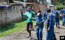 FILE - Burundian police arrest a demonstrator during clashes with security forces in the Cibitoke district of the capital Bujumbura, Burundi, May 29, 2015.