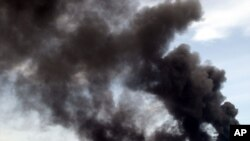 Thick plumes of black smoke rise into the air after a petroleum pipeline explosion in Nigeria. (file photo)