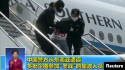 People being deported from Thailand are seen brought off an airplane by police at an unidentified location in China on July 9, 2015 in this still image taken from CCTV video aired on July 11, 2015.