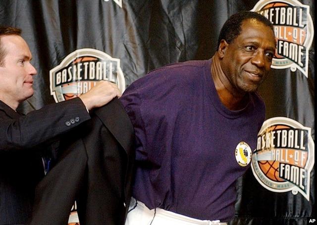 FILE - Basketball Hall of Fame CEO John Doleva, left, presents a Hall of Fame jacket to inductee Meadowlark Lemon, of the Harlem Globetrotters, at the Basketball Hall of Fame in Springfield, Massachusetts, Sept. 5, 2003.